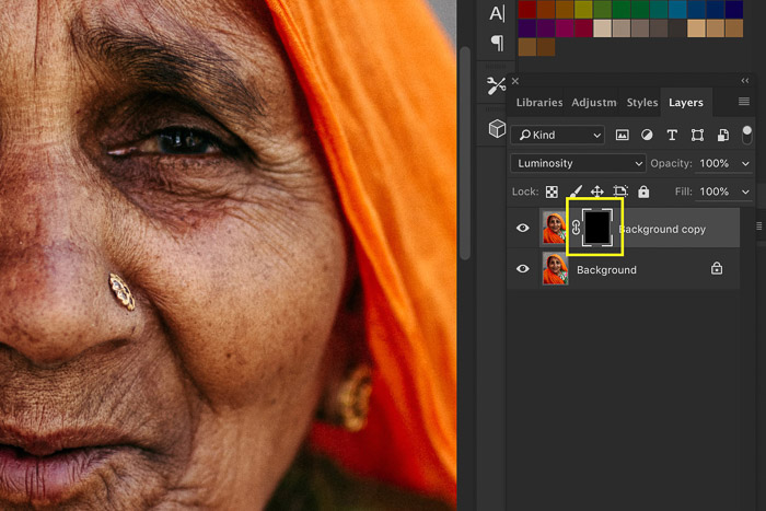 A screenshot showing how to sharpen an image in Photoshop using a portrait of an Indian woman