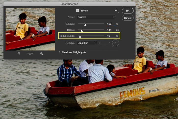 Screenshot of editing a picture in Photoshop showing a row boat in India. The Smart Sharpen setting are open in this screenshot. The Reduce Noise option is highlighted